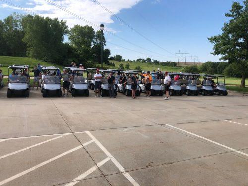 golfers in golf carts at MIB golf event