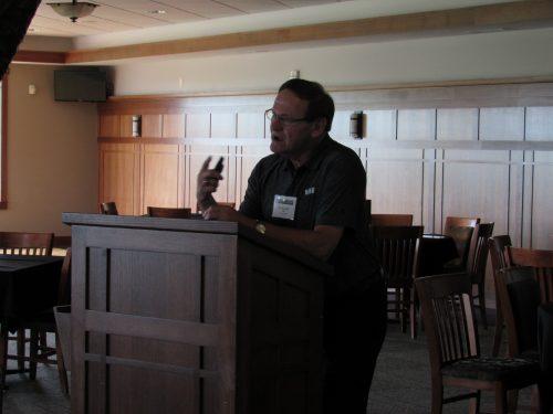 Tim Runnalls addressing Golfers at MIB golf event