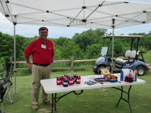 Joe Steil manning the MIB table at the MIB golf event