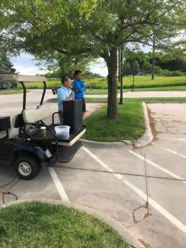 Tim Burns addressing golfers at MIB golf event