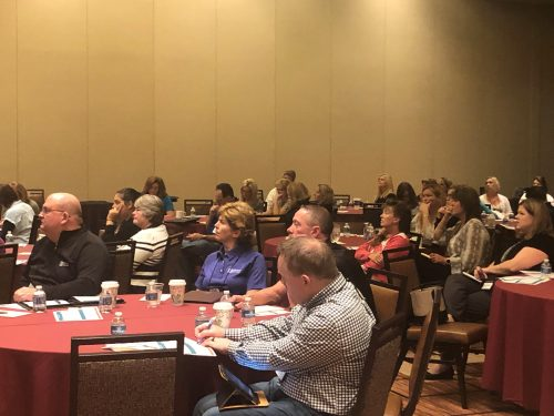 attendees listening to presentation at MIB Community Banking Conference